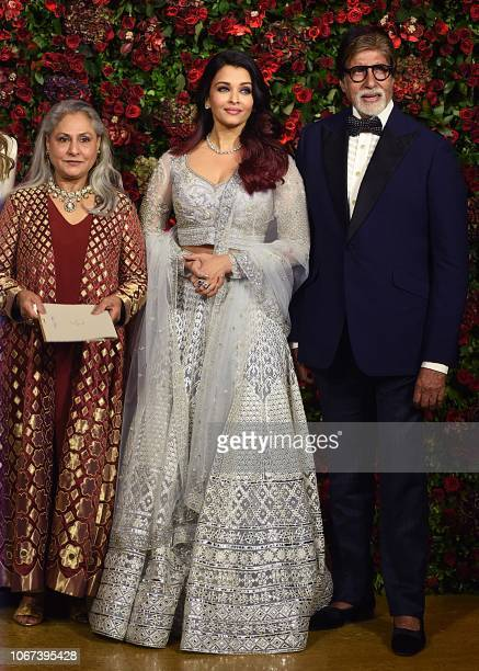 Indian Bollywood actors Jaya Bachchan Aishwarya Rai Bachchan and Amitabh Bachchan pose for a picture during the wedding reception party of actors...