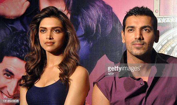 "Indian Bollywood actors John Abraham and Deepika Padukone pose for a photo during a promotional event for the upcoming Hindi action comedy film ""Desi..."