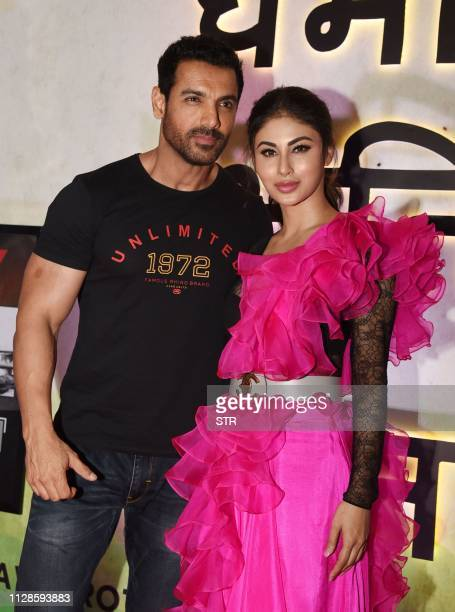 Indian Bollywood actors John Abraham and Mouni Roy pose during the trailer launch of their upcoming Indian espionage thriller Hindi film Romeo Akbar...