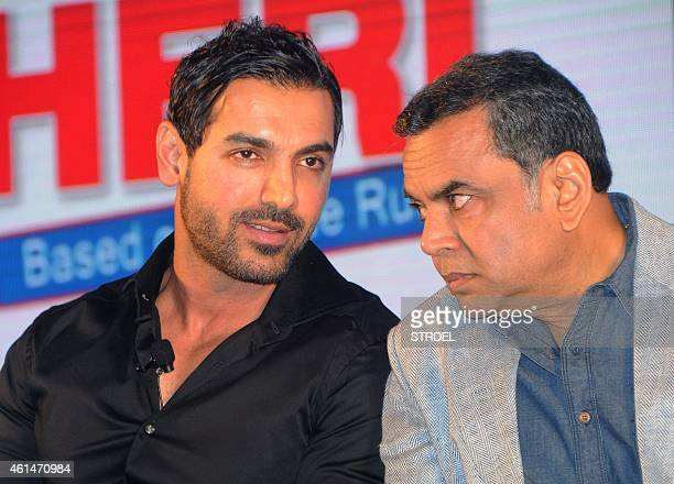 Indian Bollywood actors John Abraham and Paresh Rawal attend the mahurat of the forthcoming comedy Hindi film 'Hera Pheri 3' in Mumbai on January 12...
