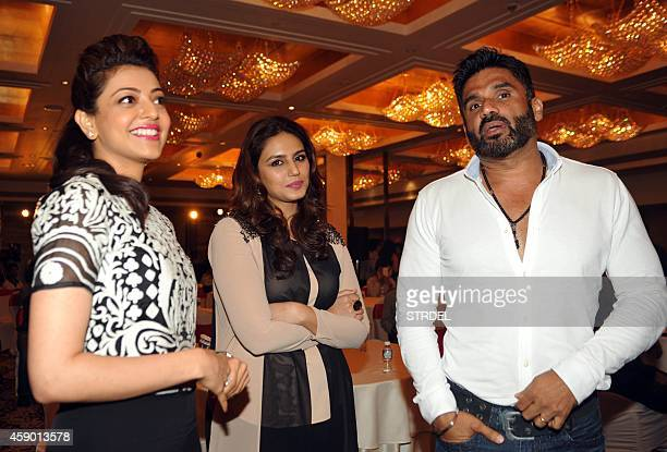 Indian Bollywood actors Kajal Aggarwal Huma Qureshi and Suniel Shetty attend the launch for the fifth Celebrity Cricket League in Mumbai on November...