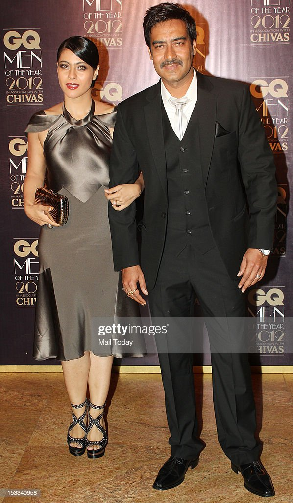 Indian Bollywood actors Kajol and Ajay Devgn during the GQ Men of the Year Awards 2012 ceremony in Mumbai on September 30 2012