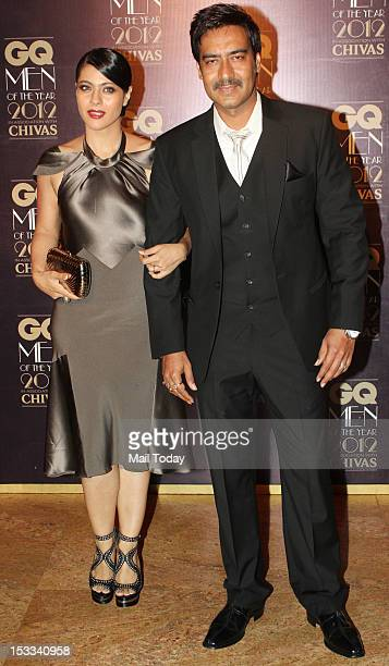 Indian Bollywood actors Kajol and Ajay Devgn during the GQ Men of the Year Awards 2012 ceremony in Mumbai on September 30, 2012.