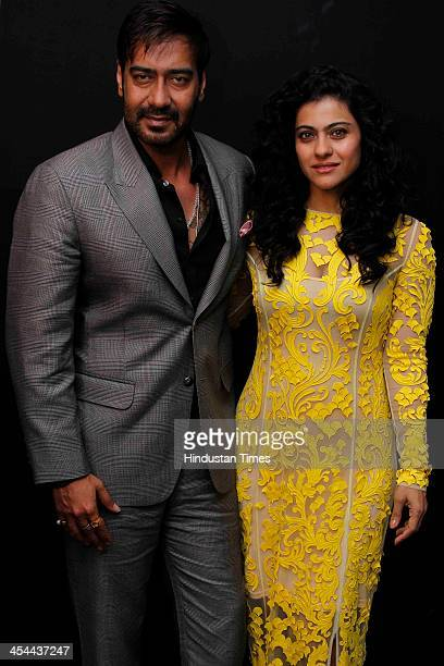 Indian bollywood actors Kajol and Ajay Devgn pose for their profile shoot at Taj Palace Hotel on December 6, 2013 in New Delhi, India. Kajol and Ajay...