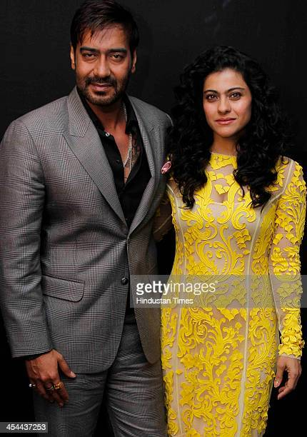 Indian bollywood actors Kajol and Ajay Devgn pose for their profile shoot at Taj Palace Hotel on December 6 2013 in New Delhi India Kajol and Ajay...