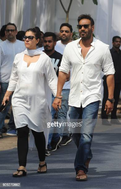 Indian Bollywood actors Kajol Devgn and Ajay Devgan attend the funeral of legendary late Bollywood actress Sridevi Kapoor in Mumbai on February 28...