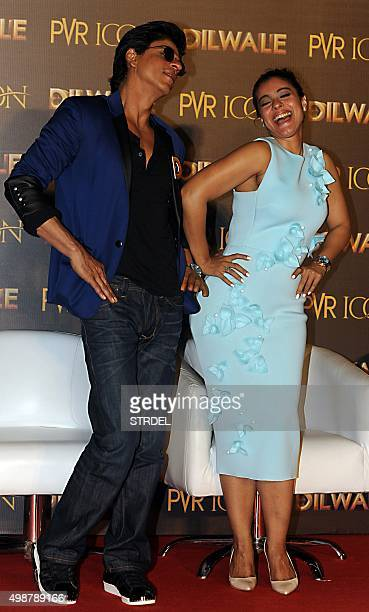 Indian Bollywood actors Kajol Devgn and Shah Rukh Khan pose for a photograph during a promotional event for the forthcoming Hindi film 'Dilwale'...