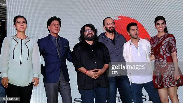 Indian Bollywood actors Kajol Devgn Shah Rukh Khan music director Pritam Sharma film director Rohit Shetty actors Varun Dhawan and Kriti Sanon pose...