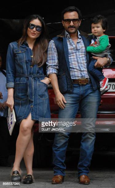 Indian Bollywood actors Kareena Kapoor and Saif Ali Khan pose for a photograph with their son Taimur during an event to mark Christmas in Mumbai on...