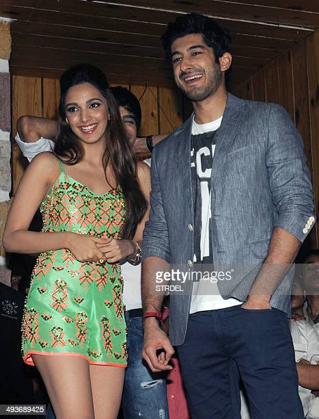 Indian Bollywood actors Kiara Advani and Mohit Marwah pose for a photograph during a promotional event for the forthcoming Hindi film F*UGLY directed...