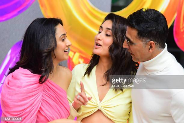 Indian Bollywood actors Kiara Advani Kareena Kapoor Khan and Akshay Kumar interact during the trailer launch event of their upcoming comedydrama...