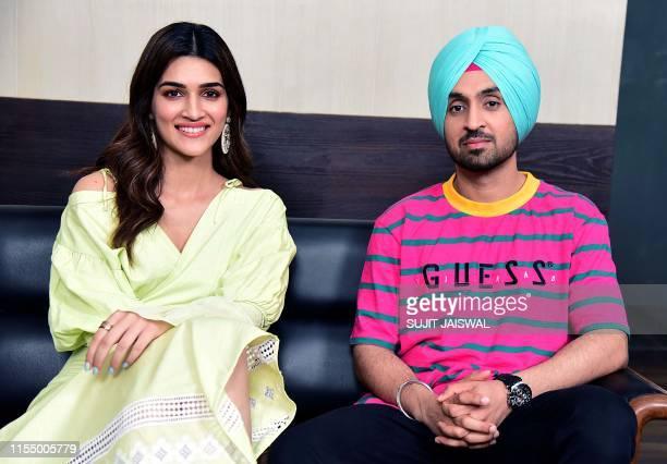 Indian Bollywood actors Kriti Sanon and Diljit Dosanjh pose during a promotion of their upcoming romantic comedy Hindi film 'Arjun Patiala' in Mumbai...