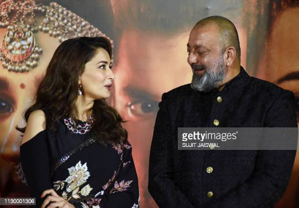 Indian Bollywood actors Madhuri Dixit and Sanjay Dutt attend the teaser launch of their upcoming period drama Hindi film Kalank in Mumbai on March 12...