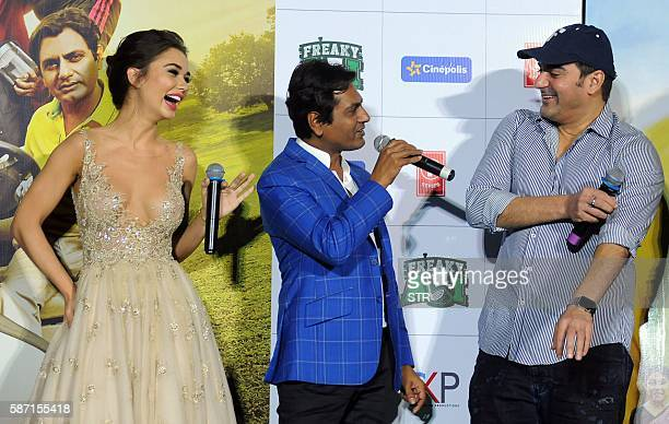 Indian Bollywood actors Nawazuddin Siddiqui and Arbaaz Khan share a light moment with British actress Amy Jackson during the trailer launch of their...