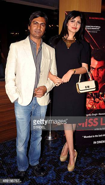 Indian Bollywood actors Nawazuddin Siddiqui and Niharika Singh pose during the first look of upcoming Hindi film Miss Lovely in Mumbai on December 23...