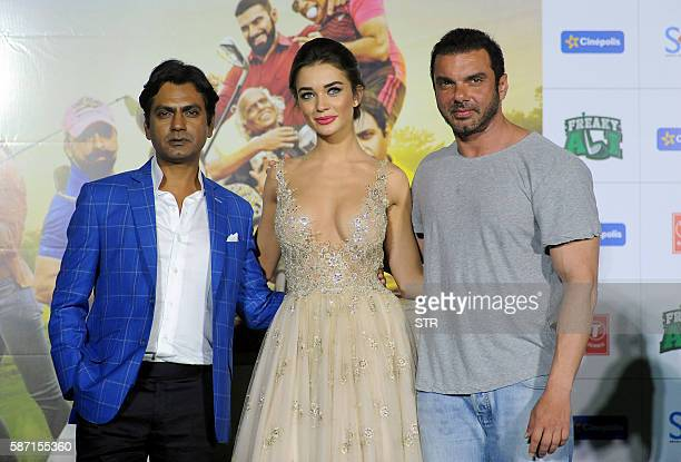 Indian Bollywood actors Nawazuddin Siddiqui and Sohail Khan pose with British actress Amy Jackson during the trailer launch of their home production...