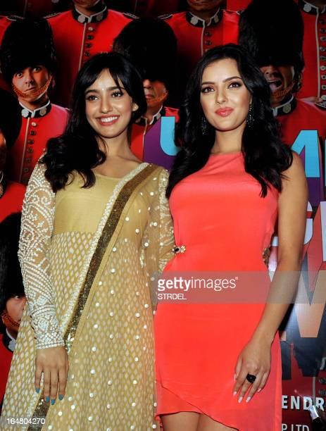 Indian Bollywood actors Neha Sharma and Australian model/ actress Kristina Akheeva look on during the launch of the forthcoming comedy 'Yamla Pagla...