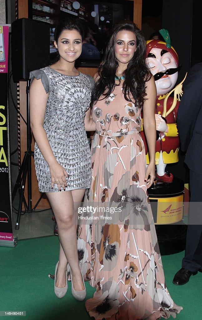 Indian Bollywood actors Parineeti Chopra and Neha Dhupia at IIFA Rocks green carpet on the 2nd day of 13th International Indian Film Academy Awards...