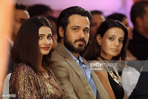 Indian Bollywood actors Prachi Desai Emraan Hashmi and Ameesha Patel attend the launch of Rebecca Deans new designer label in Mumbai on August 18...