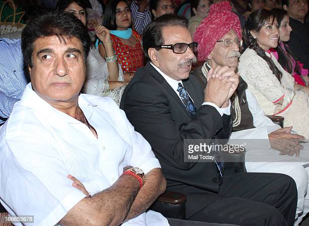 Indian Bollywood actors Raj Babbar and Dharmendra during the Baisakhi celebration in Mumbai on Friday night