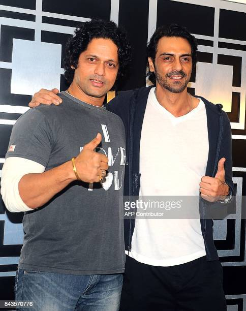 Indian Bollywood actors Rajesh Shringarpure and Arjun Rampal attend a screening of their political crime drama Hindi film 'Daddy' in Mumbai on...