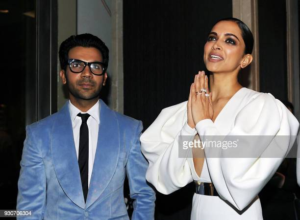 Indian Bollywood actors Rajkumar Rao and Deepika Padukone attend the 'Hello Hall of Fame Awards 2018' in Mumbai on March 11 2018 / AFP PHOTO /