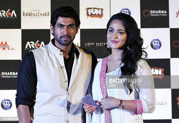 Indian Bollywood actors Rana Daggubati and Anushka Shetty attend the trailer launch of their upcoming film 'Baahubali' in Mumbai late on June 1 2015...