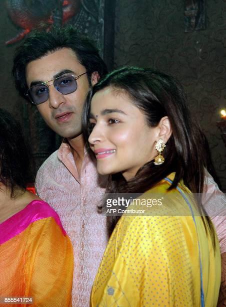 Indian Bollywood actors Ranbir Kapoor and Alia Bhatt attend the celebration of North Bombay Sarbojanin Durga Puja Samiti in Mumbai on September 29...