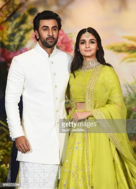 Indian Bollywood actors Ranbir Kapoor and Alia Bhatt pose for a picture during the wedding reception of actress Sonam Kapoor and businessman Anand...