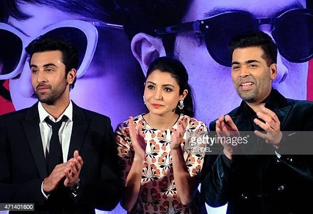 Indian Bollywood actors Ranbir Kapoor Anushka Sharma and Karan Johar look on during a promotional event for the forthcoming Hindi film 'Bombay...