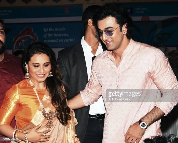 Indian Bollywood actors Rani Mukherjee and Ranbir Kapoor attend the celebration of North Bombay Sarbojanin Durga Puja Samiti in Mumbai on September...