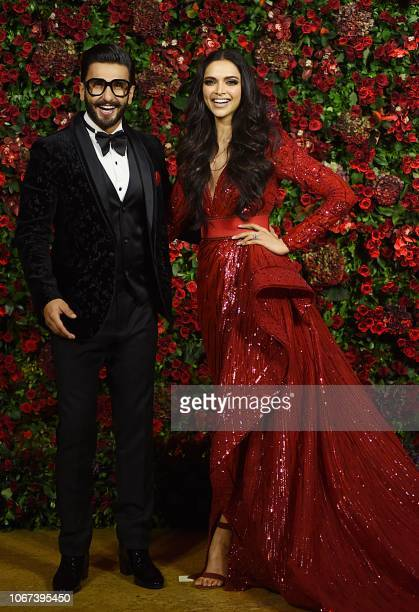 Indian Bollywood actors Ranveer Singh and Deepika Padukone pose for a photograph during their wedding reception party in Mumbai late on December 1...