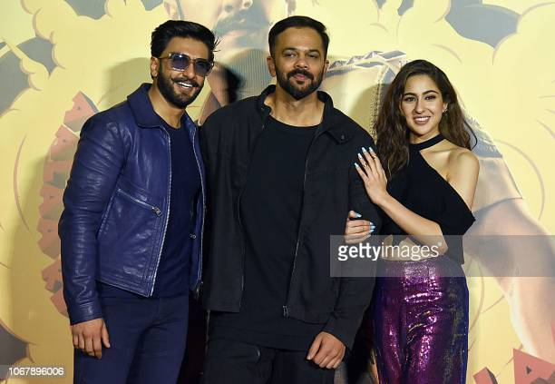 Indian Bollywood actors Ranveer Singh and Sara Ali Khan pose with the film director Rohit Shetty during the trailer launch of their upcoming Hindi...