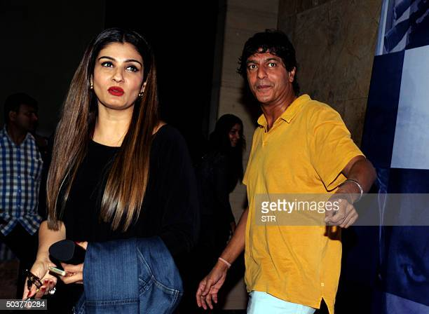 Indian Bollywood actors Raveena Tandon and Chunky Pandey attend a screening of Hindi film Wazir in Mumbai on January 6 2016 AFP PHOTO / AFP / STR