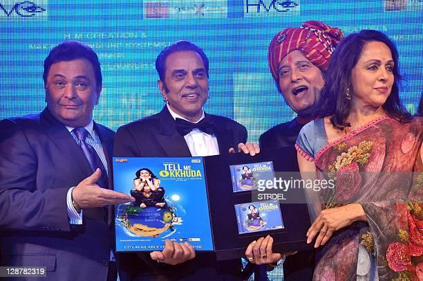 Indian Bollywood actors Rishi Kapoor Vinod Khanna and Dharmendra pose with actress Hema Malini during a function promoting the forthcoming Hindi film...