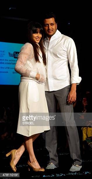 Indian Bollywood actors Riteish Deshmukh and his wife Genelia D'Souza pose for a photograph on the second day of the Lakme Fashion Week Summer/Resort...