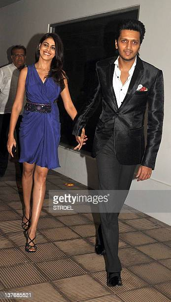 Indian Bollywood actors Ritesh Deshmukh and Genelia D'souza pose as they arrive for a prewedding party in Mumbai on January 24 2012 AFP PHOTO/STR