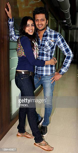Indian Bollywood actors Ritesh Deshmukh with wife Genelia D'Souza pose during a promotional event for the film Tere Naal Love Ho Gaya on the premises...