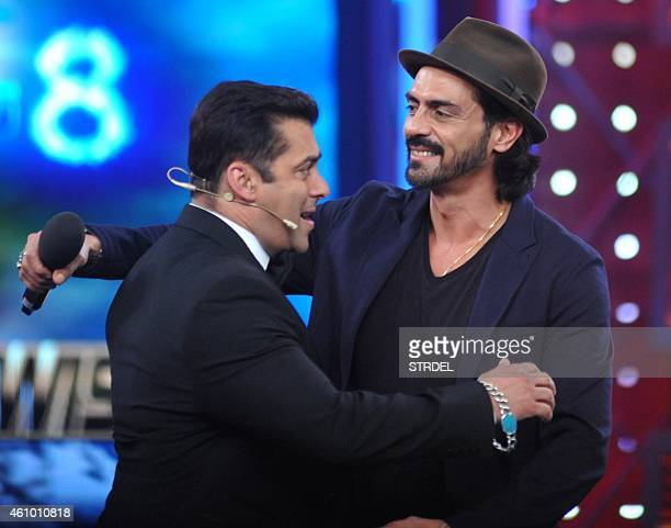 Indian Bollywood actors Salman Khan and Arjun Rampal on the set of television show Bigg Boss 8 in Lonavala on January 3 2015 AFP PHOTO/STR
