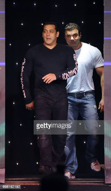 Indian Bollywood actors Salman Khan and Sohail Khan attend the promotion of their upcoming Hindi film Tubelight in Mumbai on late June 19 2017 / AFP...