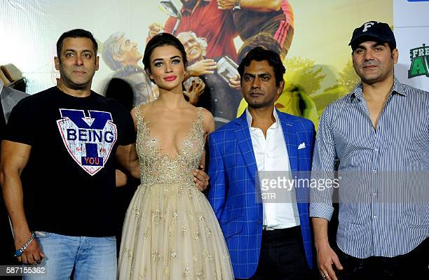 Indian Bollywood actors Salman Khan Nawazuddin Siddiqui and Arbaaz Khan pose with British actress Amy Jackson during the trailer launch of their home...