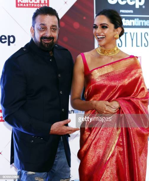 Indian Bollywood actors Sanjay Dutt and Deepika Padukone pose for a picture as they attend the 'HT India's Most Stylish Awards 2018' in Mumbai late...