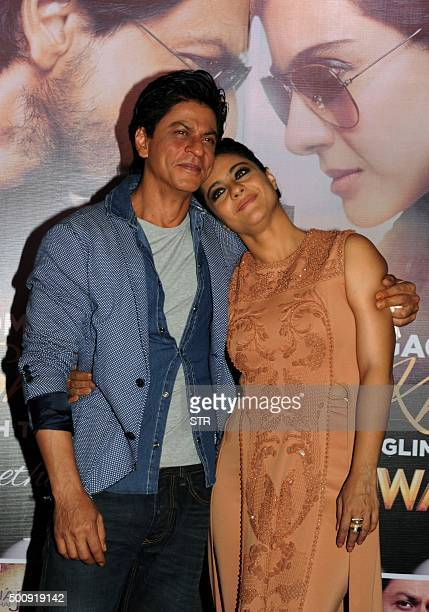 Indian Bollywood actors Shah Rukh Khan and Kajol Devgn appear at a promotional event for their upcoming Hindi film Dilwale in Mumbai on December 11...