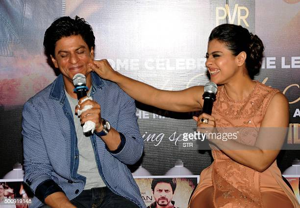 Indian Bollywood actors Shah Rukh Khan and Kajol Devgn appear at a promotional event for their upcoming Hindi film 'Dilwale' in Mumbai on December 11...