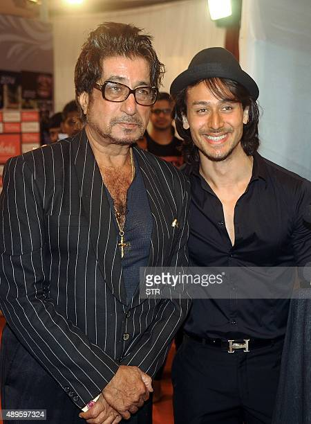 Indian Bollywood actors Shakti Kapoor and Tiger Shroff pose during the 'Suron Ke Rang Color ke Sang Salaam Shri Gulshan Kumar' musical concert in...