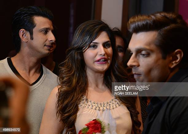 Indian Bollywood actors Sharman Joshi Zarine Khan and Karan Singh Grover take part in a promotional event for the forthcoming Hindi film 'Hate Story...
