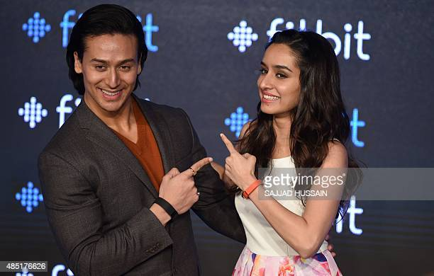 Indian Bollywood actors Shraddha Kapoor and Tiger Shroff pose for a photograph during a promotional event in New Delhi on August 25 2015 AFP PHOTO /...