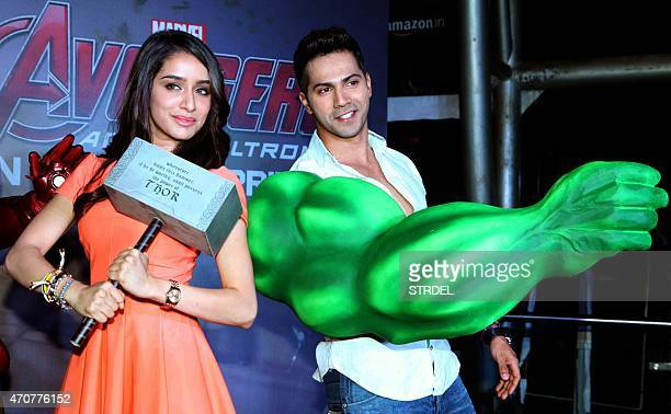 Indian Bollywood actors Shraddha Kapoor and Varun Dhawan pose for a photograph during a screening of Hollywood film 'Avengers Age of Ultron' in...