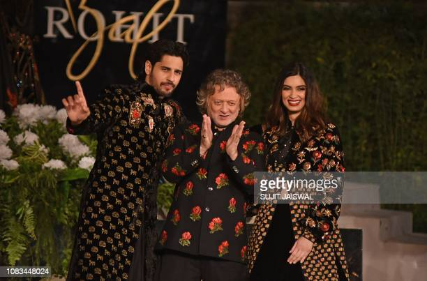 Indian Bollywood actors Siddharth Malhotra and Daina Penty gesture during a fashion show by designer Rohit Bal at the Blenders Pride Fashion Tour in...