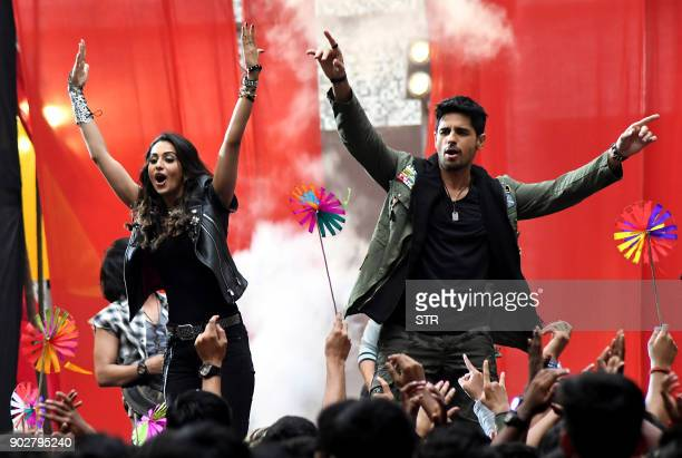 Indian Bollywood actors Siddharth Malhotra and Rakul Preet Singh gestures during the Alegria 2018 Banner Unveiling Ceremony of the Mahatma Education...